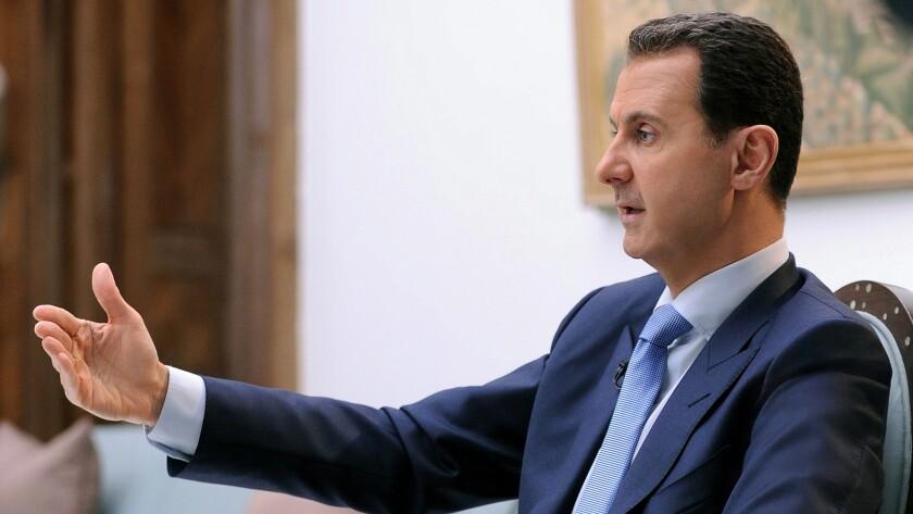 Syrian President Bashar Assad speaks during an interview in Damascus on April 3, 2017.