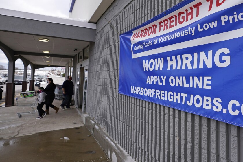 "A ""Now Hiring"" sign hangs on the front wall of a Harbor Freight Tools store in Manchester, N.H."