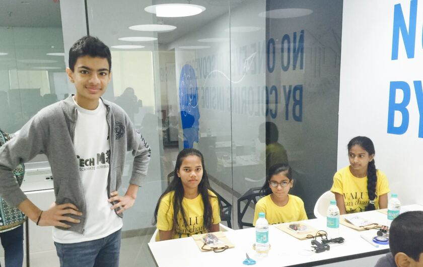 Jaiv Doshi holds a workshop to introduce  Scratch programming by building a simple robot.