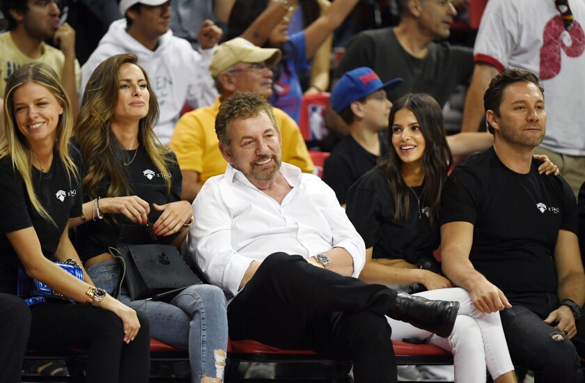 New York Knicks owner James Dolan, middle, attend a Las Vegas summer league game July 7, 2019.