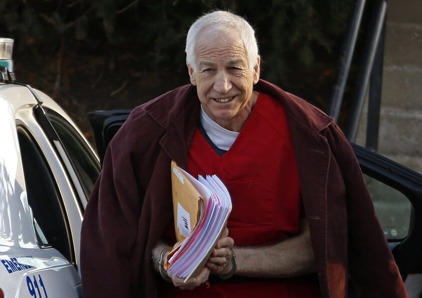 FILE - In this Jan. 10, 2013, file photo, former Penn State assistant football coach Jerry Sandusky arrives at the Centre County Courthouse for a post-sentencing hearing in Bellefonte, Pa. A new accuser is suing Sandusky, Penn State and a charity the former assistant coach founded, saying he was sexually abused about six years ago. The Centre Daily Times reported Wednesday, Sept. 3, 2014,that the case was filed in Philadelphia last month by Williamsport, Pa., attorney Bret Southard. (AP Photo/Gene J. Puskar, File)