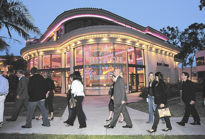 Movie-goers head to the Edwards Big Newport 6 theater during the 2015 Newport Beach Film Festival. The theater is now closed indefinitely because of the coronavirus, and this year's spring film festival has been postponed to August.