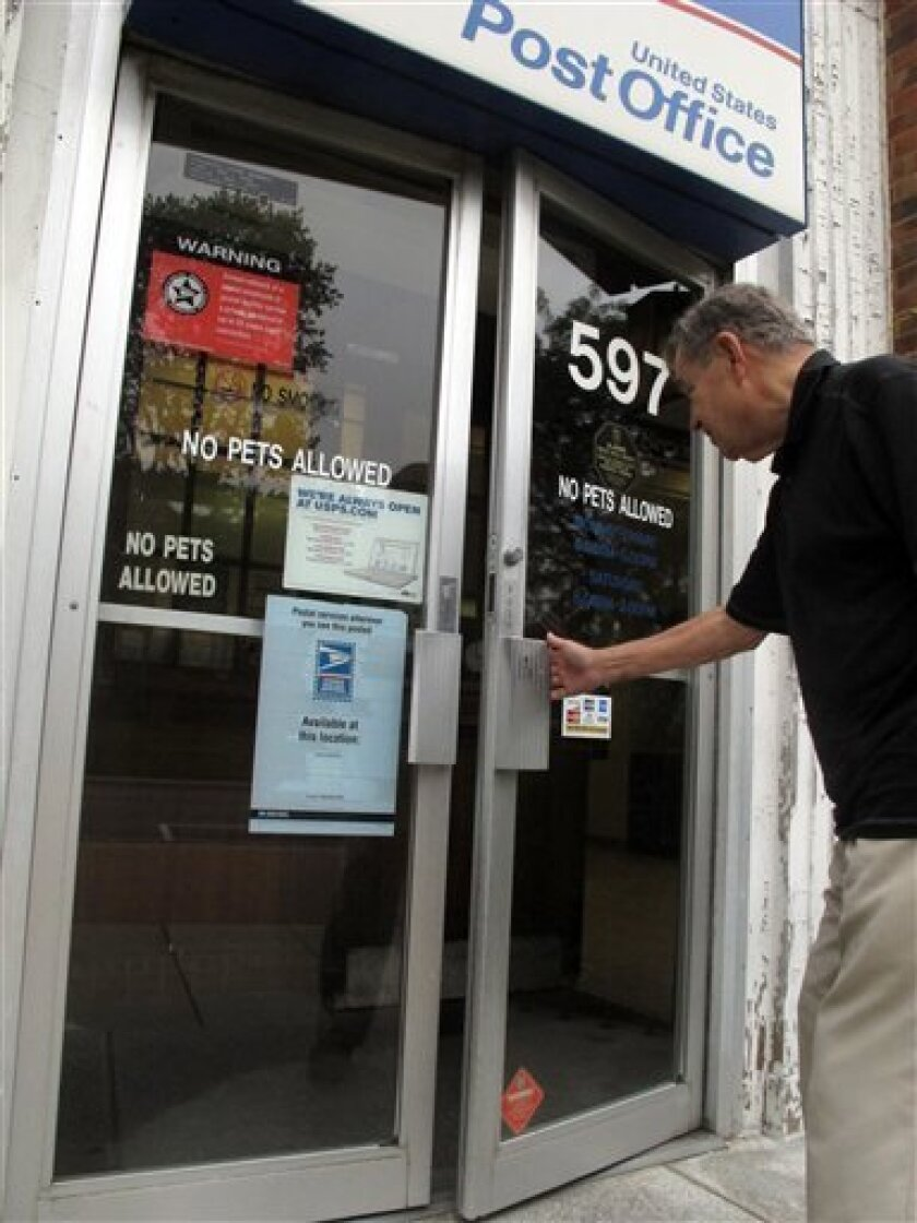In this photo taken Wednesday Sept. 7, 2011, William Scott, 79, enters a post office to mail a letter in Worthington, Ohio. Scott said he usually visits the post office three times a week to send mail. If the local post office were to shut own, would anyone miss it? Yes, many people are saying as the U.S. Postal Service is desperate to streamline its operations and save money. (AP Photo/Kantele Franko)