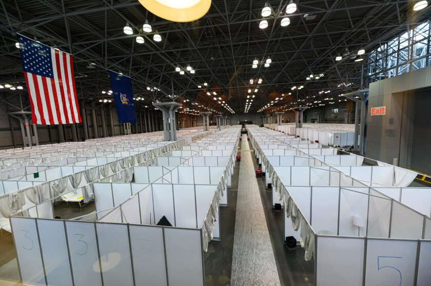 A 3,000-bed temporary hospital for non-coronavirus patients is set up by the Army Corps of Engineers inside the Jacob Javits Convention Center in New York City.