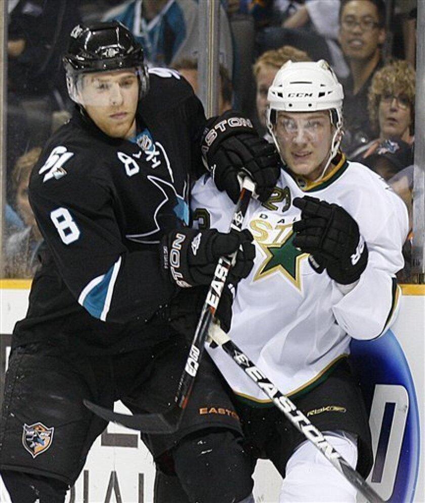 San Jose Sharks' Joe Pavelski, left, checks Dallas Stars' Tom Wandell during the first period of an NHL hockey game Thursday, March 31, 2011, in San Jose, Calif. (AP Photo/Ben Margot)