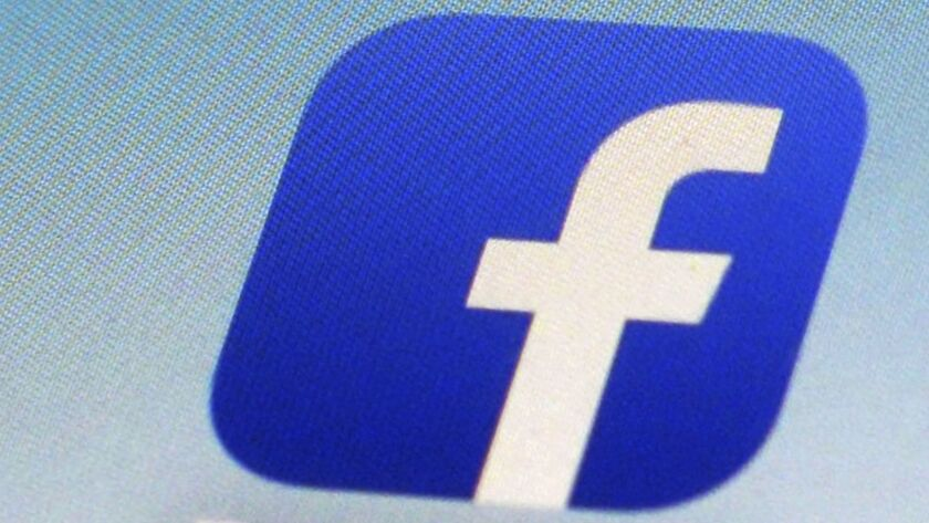 FILE - This Feb. 19, 2014, file photo, shows a Facebook app icon on a smartphone in New York. Facebo