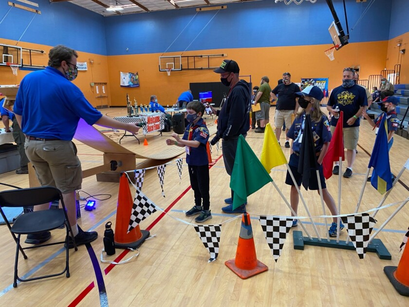 Contestants getting ready to compete in the 68th annual Pinewood Derby