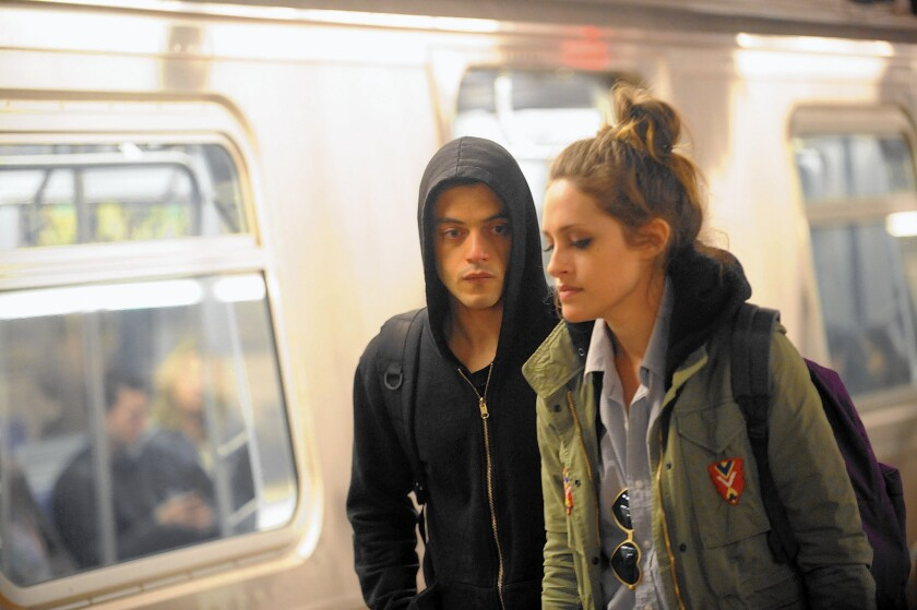 """Rami Malek and Carly Chaikin on the set of """"Mr. Robot."""""""
