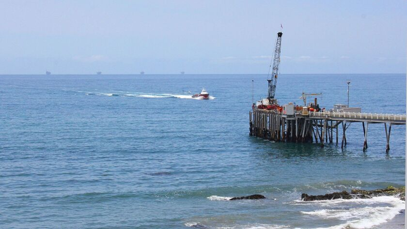This May 16, 2015 photo shows oil drillings offshore of a service pier in the Santa Barbara Channel