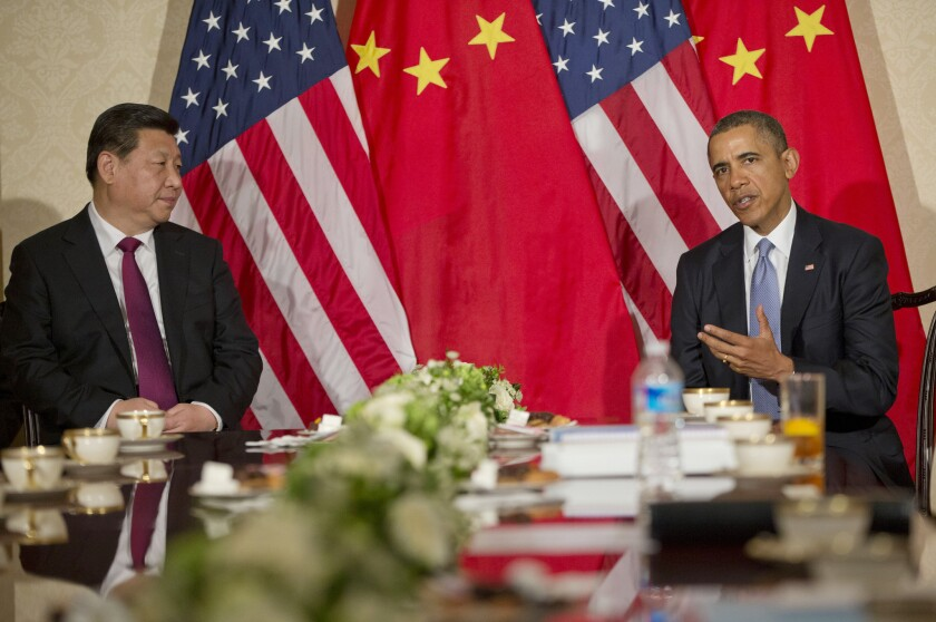 President Obama and Chinese President Xi Jinping appear before the news media before their meeting Monday at the U.S. ambassador's residence in The Hague, Netherlands.