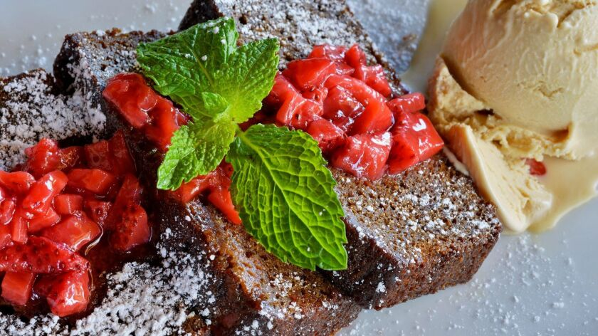 Dessert options at Bleu Boheme include pain d'epice, warm gingerbread with strawberry confiture and caramel ice cream