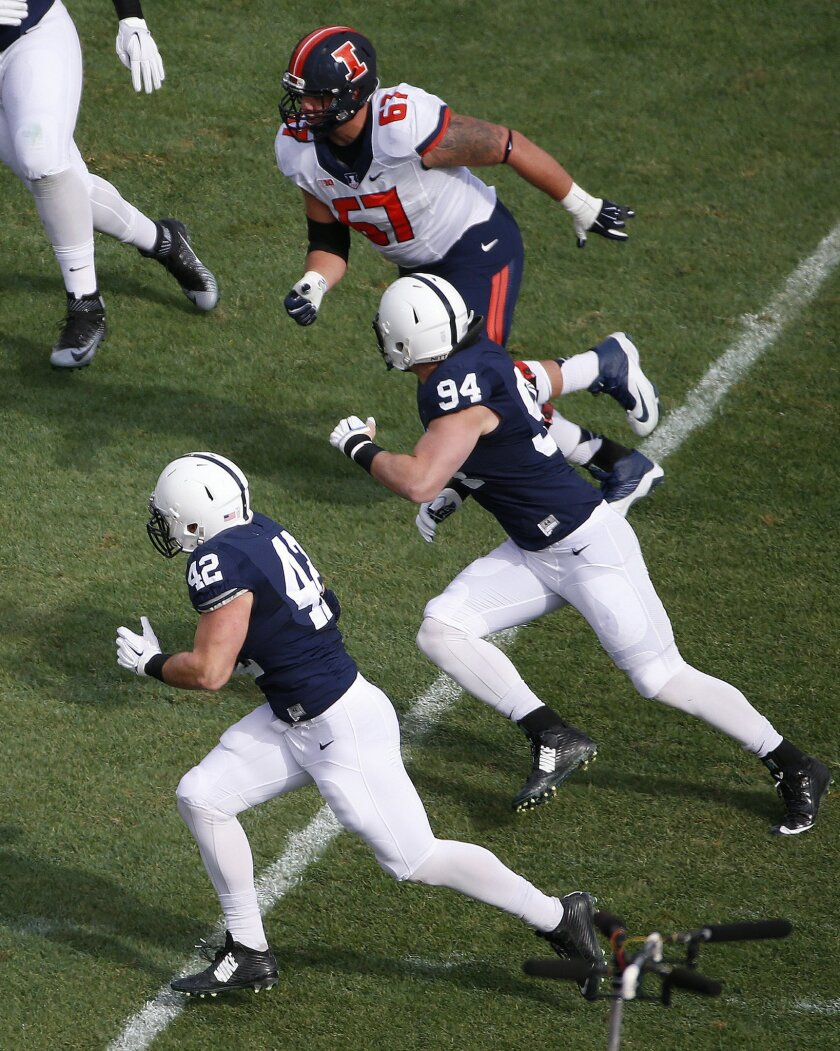 Penn State linebacker Troy Reeder (42) runs after intercepting a pass from Illinois quarterback Wes Lunt (12) during the first half of an NCAA college football game in State College, Pa., Saturday, Oct. 31, 2015. (AP Photo/Gene J. Puskar)