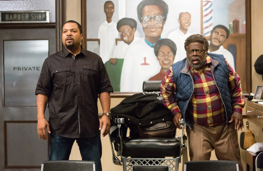 "Ice Cube, left, and Cedric The Entertainer appear in ""Barbershop: The Next Cut."""
