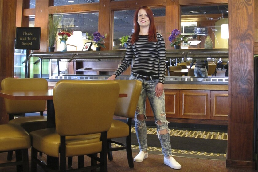 Courtney Keith in the restaurant that let her go after Ohio banned sit-down dining.
