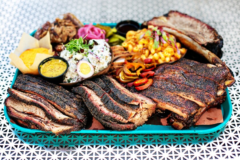 A spread of barbecue and sides from Heritage BBQ in San Juan Capistrano.