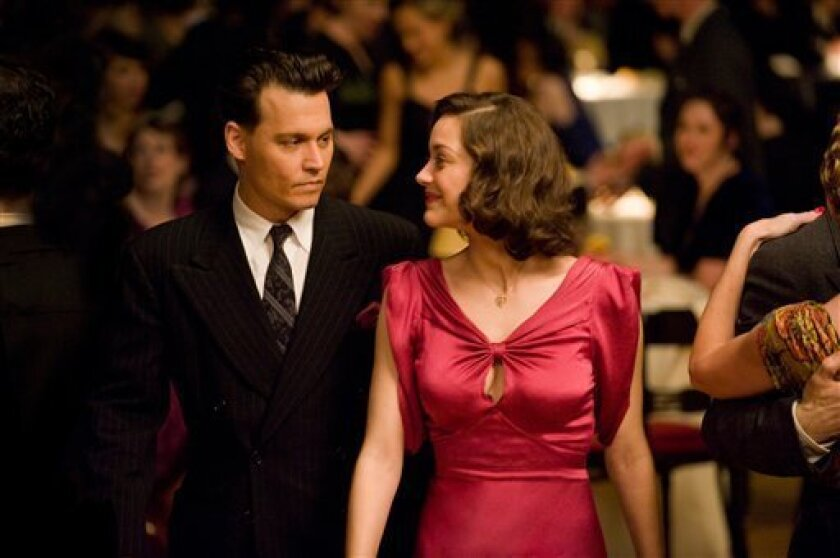 Review: `Public Enemies' dazzles the eye but drags - The San Diego ...