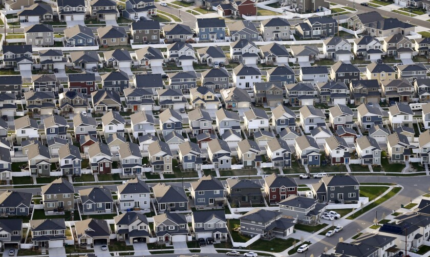 This April 13, 2019, file photo, shows rows of homes, in suburban Salt Lake City.