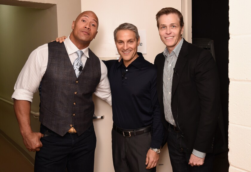 """Dwayne """"The Rock"""" Johnson, Ari Emanuel and Patrick Whitesell pose for a photo."""
