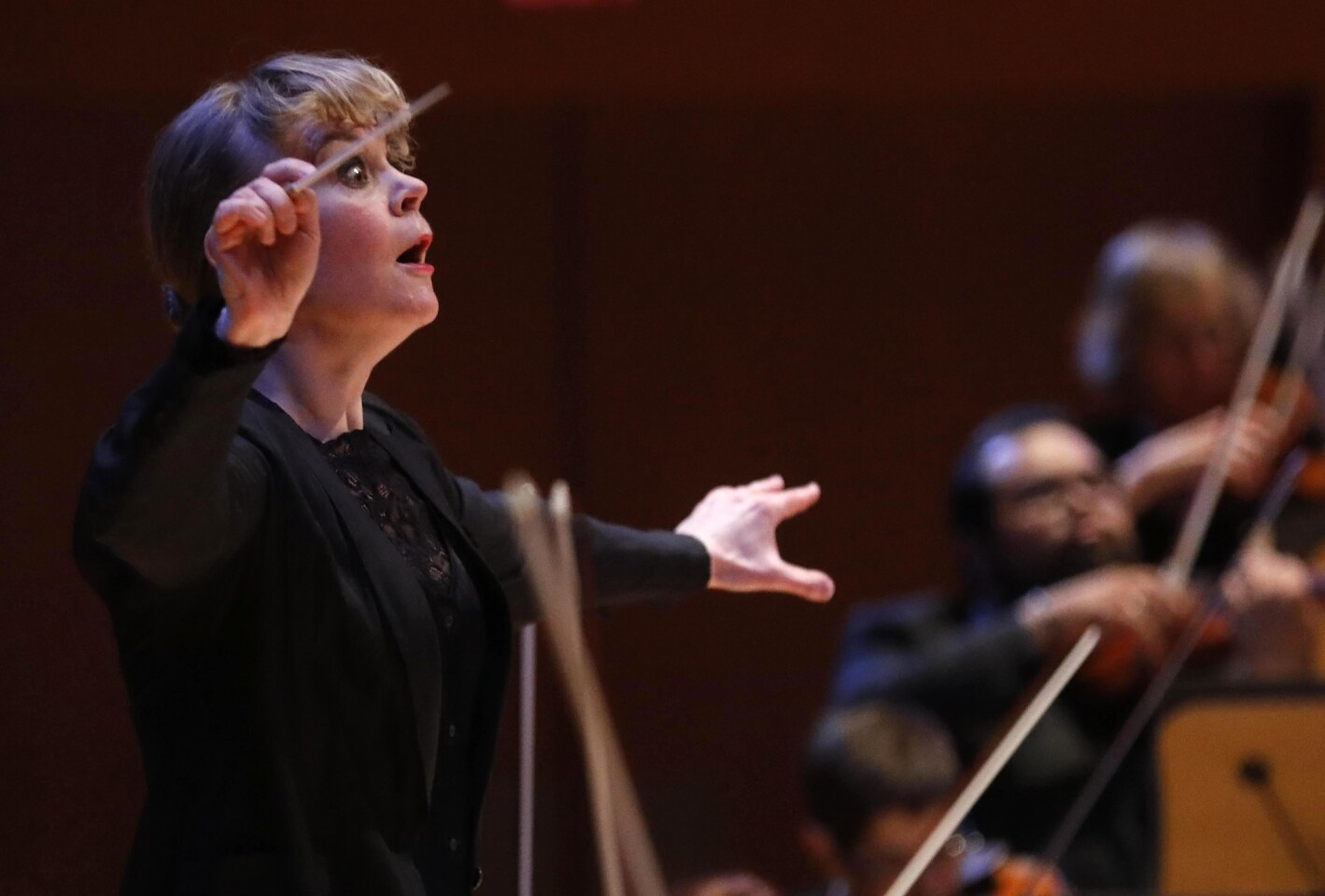 """Susanna Malkki, the new principal guest conductor of the LA Phil, conducts the Los Angeles Philharmonic in a performance of Richard Strauss' """"An Alpine Symphony, Op.64"""" at the Disney Concert Hall on Jan. 19."""