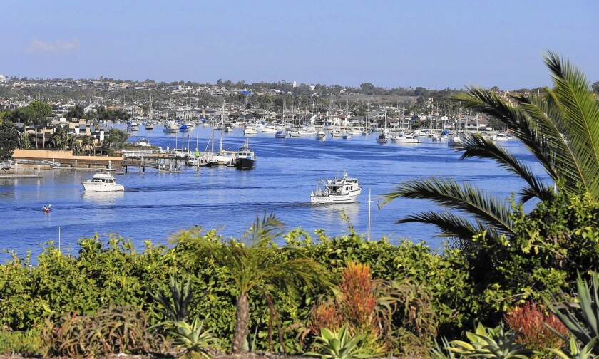 Boaters navigate Newport Harbor in Newport Beach. In an effort to ease crowding during the busy summer boating season, the Harbor Commission recommended in 2015 that the city test a second anchorage.