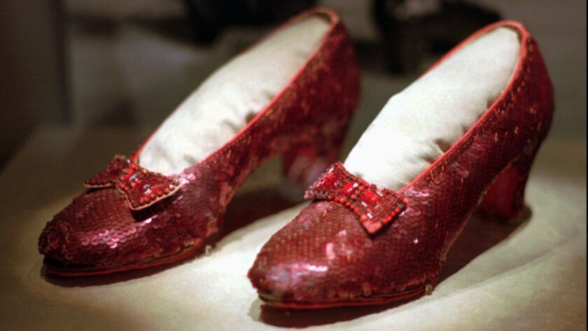 FILE - This April 10, 1996, file photo shows one of the four pairs of ruby slippers worn by Judy Gar