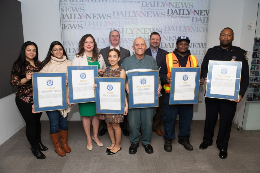 Daily News Hometown Heroes and their representatives are pictured Friday with their awards. At rear are Daily News Editor-in-Chief Robert York and Publisher Grant Whitmore.