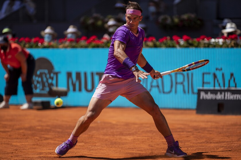 Spain's Rafael Nadal returns the ball to Germany's Alexander Zverev during their match at the Mutua Madrid Open tennis tournament in Madrid, Spain, Friday, May 7, 2021. (AP Photo/Bernat Armangue)