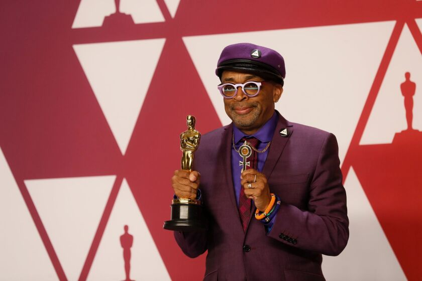 """Spike Lee, winner of the adapted screenplay award for """"BlacKkKlansman,"""" poses in the press room during the 91st Academy Awards."""
