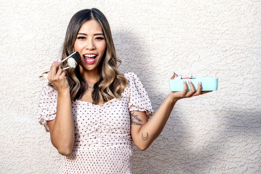 """Jessica Woo, mother of three, has become a TikTok sensation with her """"how to"""" videos of bento box lunches for children."""