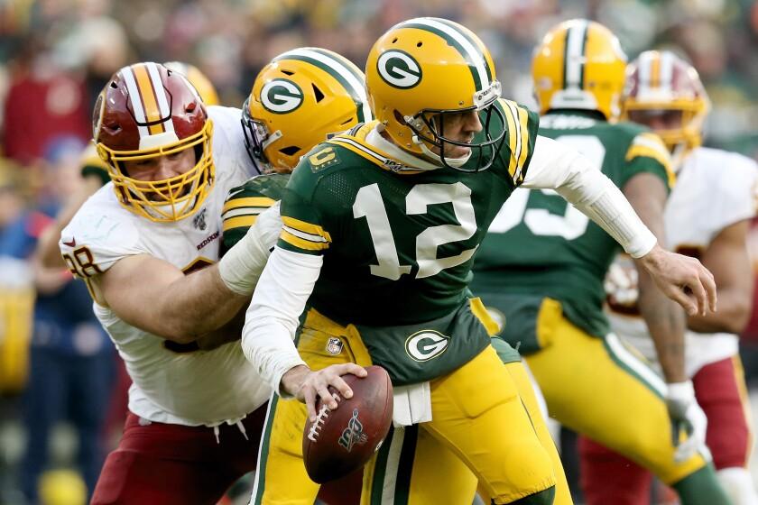 Washington Redskins defensive end Matthew Ioannidis sacks Green Bay Packers quarterback Aaron Rodgers.