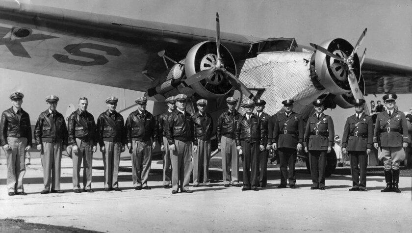 March 4, 1934: Members of L.A. County Sheriff Eugene Biscailuz's volunteer aero squadron pose in front of a Fokker aircraft.