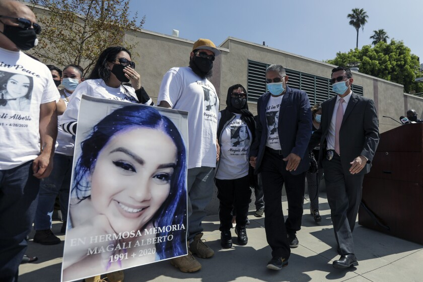 Family members of shooting victim Magali Alberto attend an LAPD news conference.