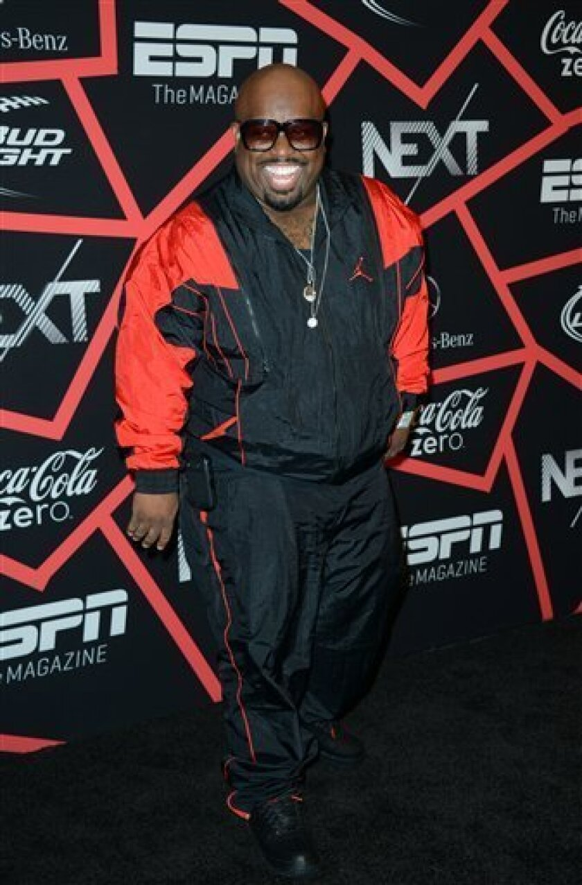 """Cee Lo Green arrives at ESPN The Magazine's """"Next"""" Event on Friday, Feb. 1, 2013 in New Orleans. (Photo by Jordan Strauss/Invision/AP)"""
