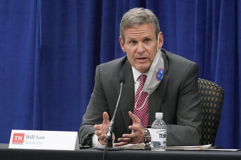 FILE - Gov. Bill Lee speaks during the Tennessee Higher Education Commission session of the state budget hearings on Nov. 10, 2020, in Nashville, Tenn. The health department in Tennessee's most populous county reinstituted a face mask requirement Wednesday, Aug. 18, 2021, for indoor public places such as restaurants, bars and other businesses as a surge in COVID-19 cases strains hospital resources and causes concern in schools. The announcement comes two days after Lee issued an order allowing parents of K-12 students to opt out of mask requirements issued for schools. (AP Photo/Mark Humphrey, File)