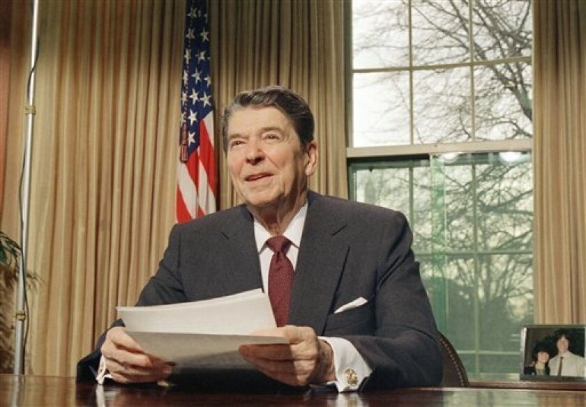 FILE - In this Jan. 15, 1987 file photo, President Ronald Reagan speaks about Martin Luther King Jr. during a televised speech at the White House in Washington.
