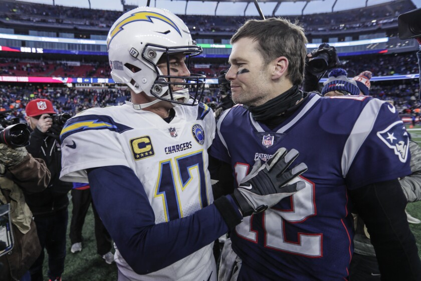 Tom Brady (right) and the Patriots eliminated the Philip Rivers and the Chargers from the playoffs two seasons ago.