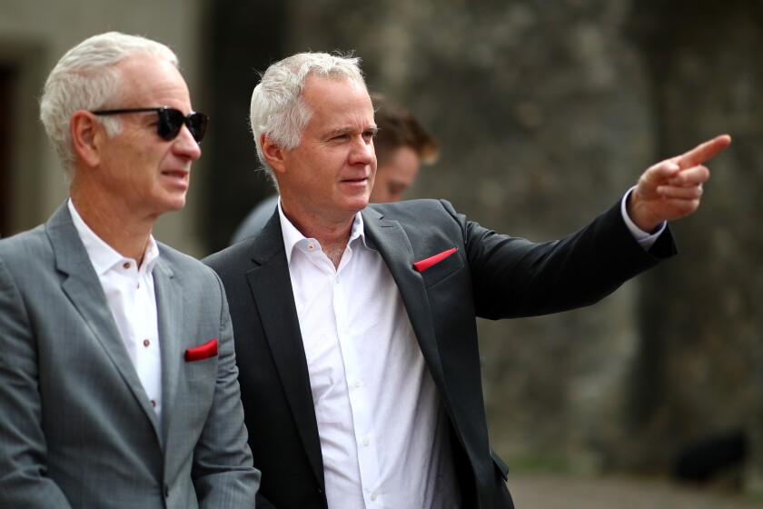 Patrick McEnroe, right, and John McEnroe arrive for the welcome ceremony prior to the Laver Cup on Sept. 18, 2019, in Geneva.