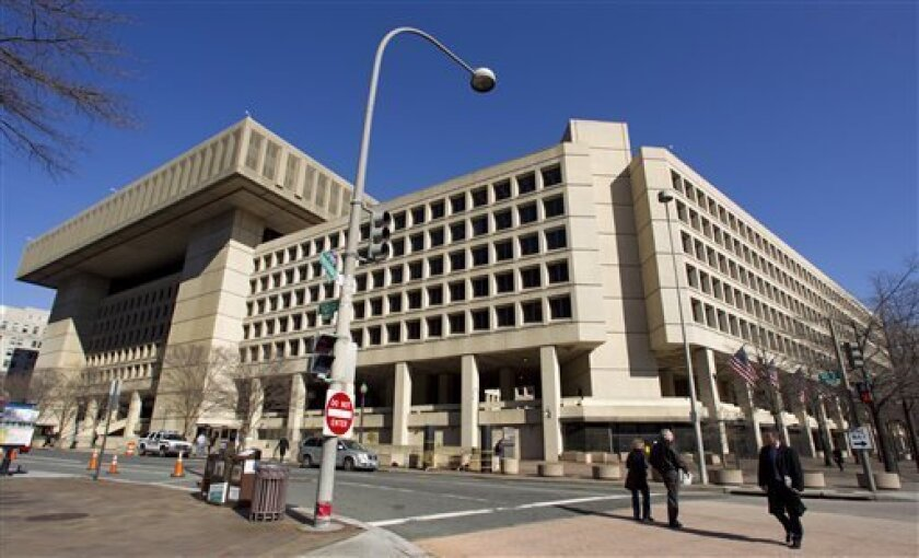 FILE - This Feb. 3, 2012 file photo shows the Federal Bureau of Investigation (FBI) headquarters in Washington. Trying to ratchet up pressure on Congress, the White House on Friday detailed what it said would be the painful impact on the federal work force and certain government assistance programs