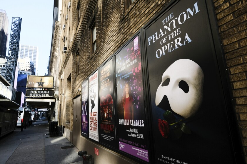 FILE - Broadway posters hang outside the Richard Rodgers Theatre during Covid-19 lockdown in New York on May 13, 2020.
