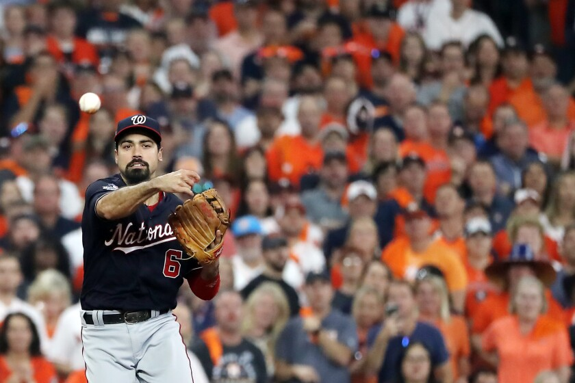 Washington Nationals' Anthony Rendon throws out the runner against the Houston Astros during the first inning in Game 2 of the World Series on Wednesday in Houston.