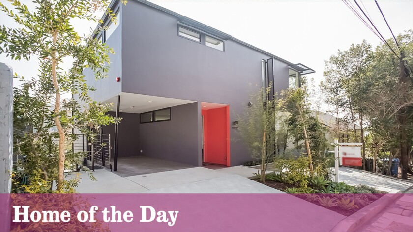 A feng shui-friendly front door provides a warm welcome for this newly constructed modernist home.