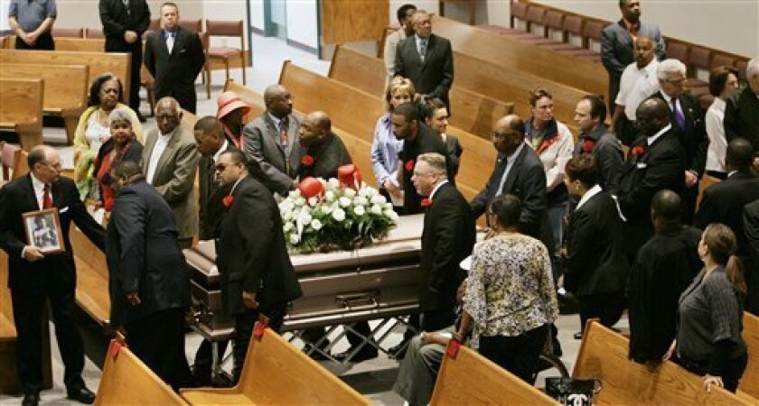 Pallbearers bring the casket of former heavyweight boxing champion Greg Page into Our Lady of Mt. Carmel Church for his funeral in Louisville, Ky., Monday, May 4, 2009. (AP Photo/Ed Reinke)