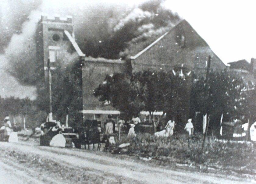 Mount Zion Baptist Church in Tulsa, Okla., burns during the 1921 Tulsa Race Riot.