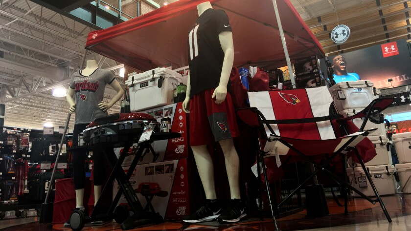 A sporting goods store display in Phoenix offers Arizona Cardinals fans plenty of gear from which to choose.