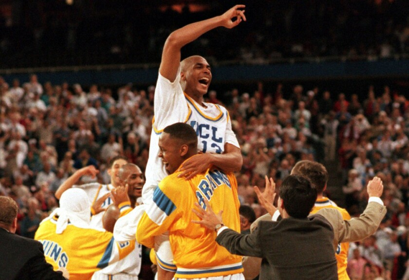 Ed O'Bannon is lifted into the air by UCLA teammate Ike Nwankwo after the Bruins' win over Arkansas in the 1995 NCAA title game.