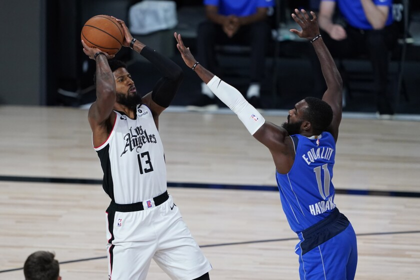 Dallas' Tim Hardaway Jr. covers the Clippers' Paul George.