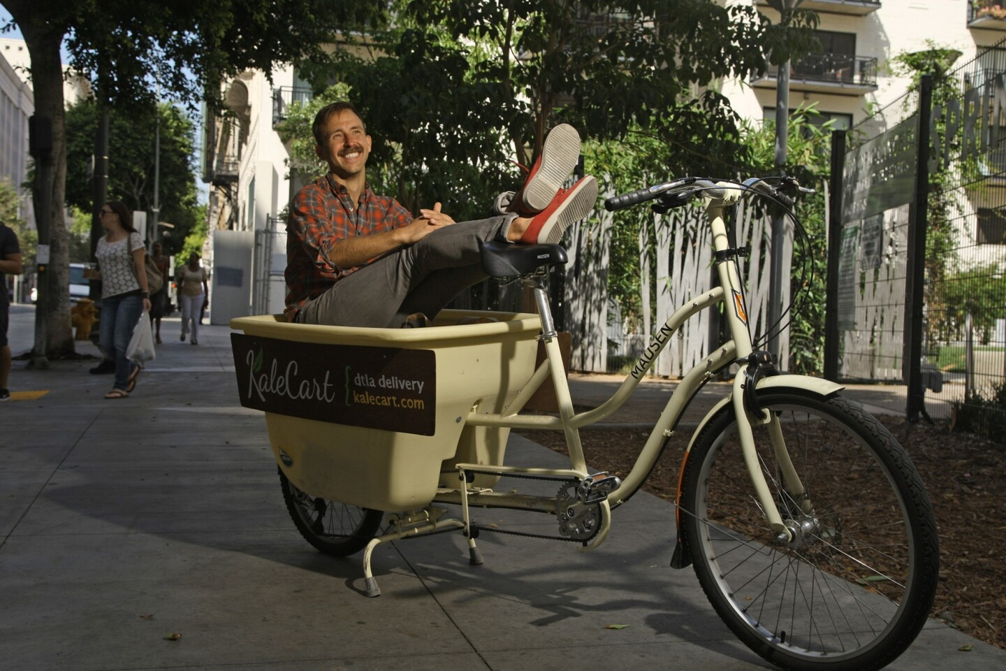 Ryan Matteson of Kale Cart uses a bike with trailer for deliveries in downtown L.A. The service relies solely on bicycles to bring customers their goods.