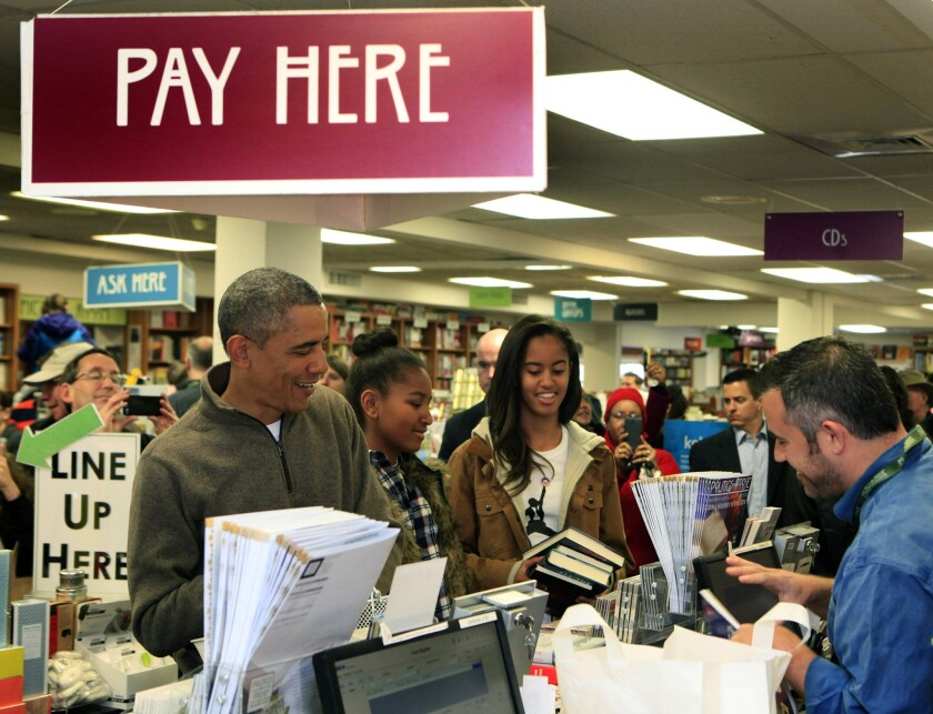 President Obama and daughters Sasha, center, and Malia purchase books at Washington's Politics and Prose bookstore for Small Business Saturday on Nov. 29.