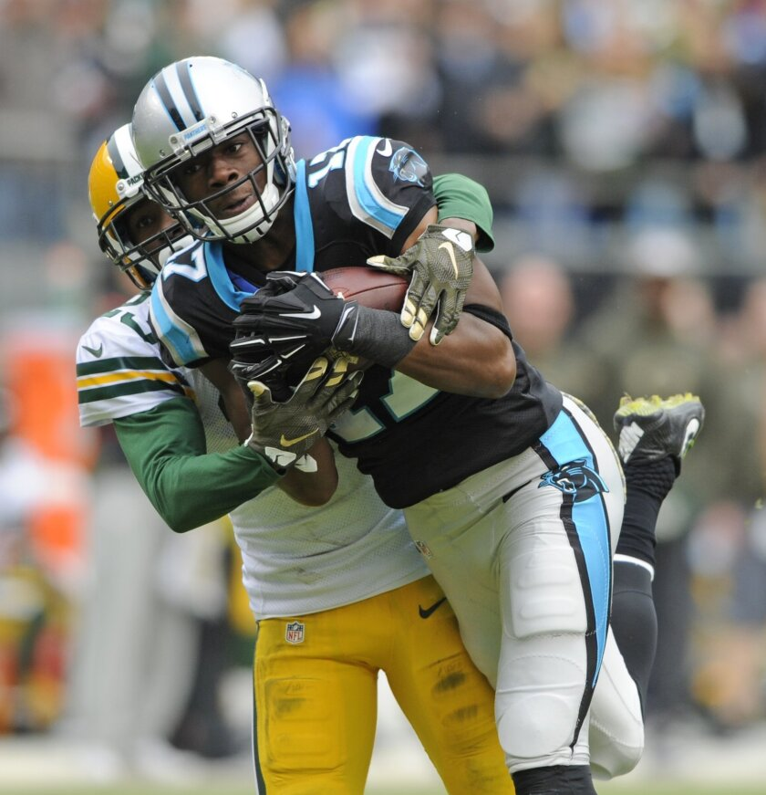 Carolina Panthers' Devin Funchess, front, catches a pass as Green Bay Packers' Damarious Randall, back defends in the first half of an NFL football game in Charlotte, N.C., Sunday, Nov. 8, 2015. (AP Photo/Mike McCarn)
