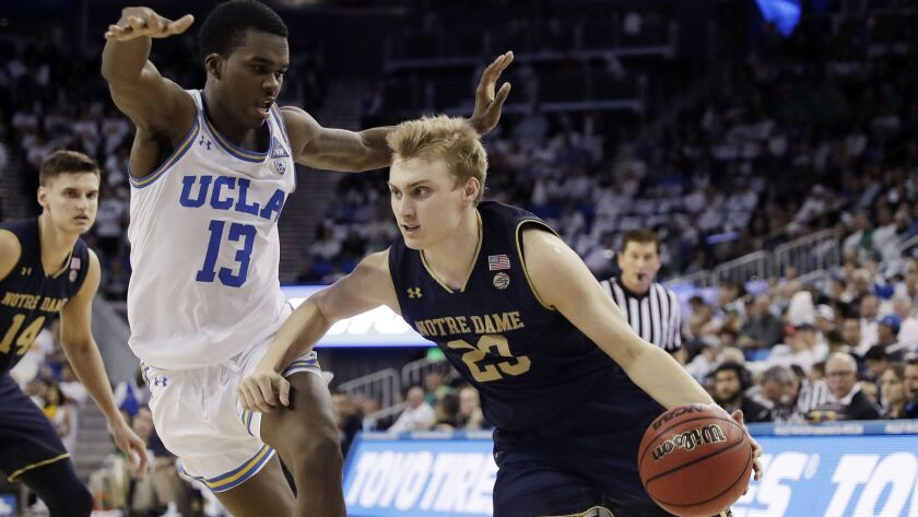 Notre Dame guard Dane Goodwin (23) dribbles past UCLA guard Kris Wilkes (13) during the first half on Saturday.